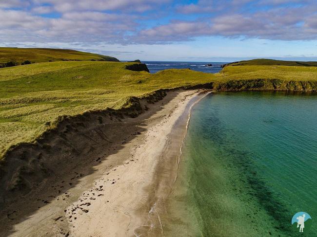 scousburgh sands drone shetland travel guide
